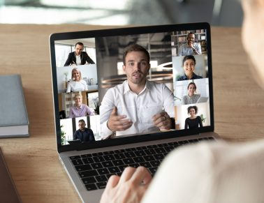 People working from home via video chat.